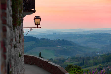 view at the valley from the San Gimignano walls at sunset time Stock Photo