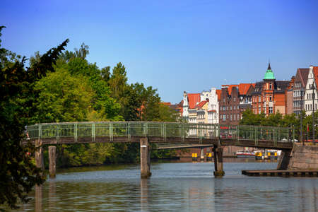 bridge and houses on the bank of the river Trave, Lubeck Stock Photo