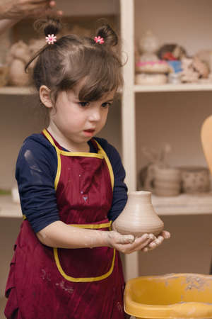 pottery workshop - girl sculpts from clay
