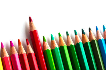 leadership concept with one pencil standing out of crowd of other pencils  Stock Photo