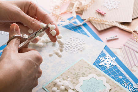scrapbook background. Girl make christmas card and tools with decoration   Stock Photo