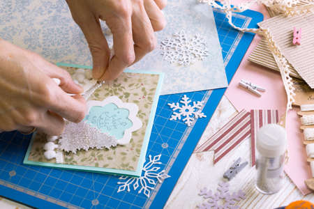 scrapbook background. Girl make christmas card and tools with decoration  写真素材