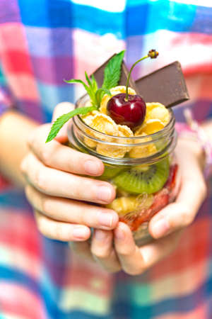 healthy diet. girl holding oatmeal with berries and fruits