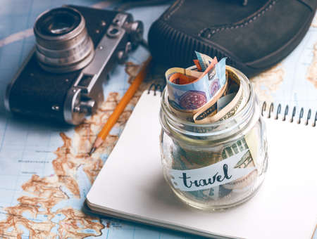 wanderlust. adventure concept. background - what to take for a trip - camera, jar with money,  shoes Archivio Fotografico