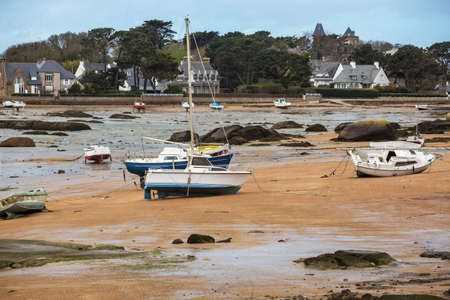 Tregastel. boats at low tide on the coast of Brittany, France  Stock Photo