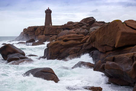 lighthouse Phare de Men Ruz and typical Brittany coast at  the Tregastel in the north of France. Reklamní fotografie - 100383032