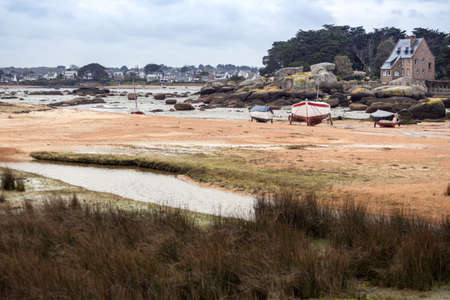 Tregastel. boats at low tide on the coast of Brittany, France