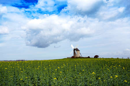 old traditional normandian windmill at the field, Normandy, France Stok Fotoğraf