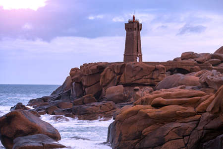 lighthouse Phare de Men Ruz and typical Brittany coast at  the Tregastel in the north of France.