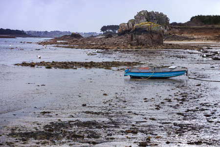 Plougouskant. boats at low tide on the coast of Brittany, France