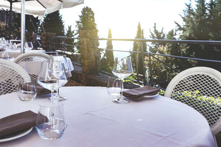 cafe. Served table in the background of the Tuscan landscape. Tuscany, Italy