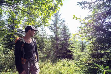 happy smiling man hiker at the  mountains. Carpathians, Ukraine.