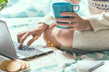 beautiful cozy morning - girl sitting with a laptop Stock Photo
