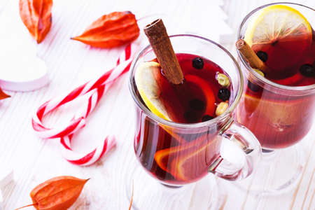 delicious mulled wine with cinnamon, lemon, cardamom poured over glasses. Christmas