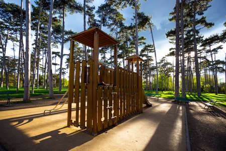 playground at the beautiful Bois de Boulogne in paris at sunset, france