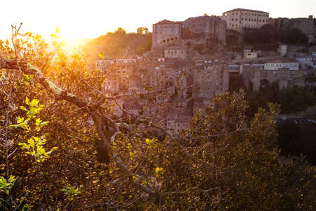 Top view of the old  famous tuff city of Sorano at the dawn, province of Siena. Tuscany, Italy
