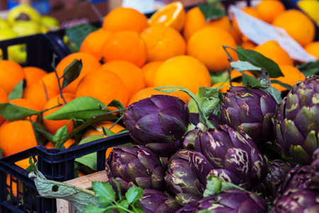 market and fruit. artichoke in the foreground Banco de Imagens