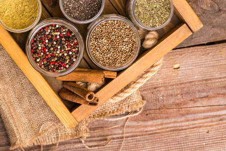 herbs and spices. cinnamon, pepper mix, flax seeds, chia and coriander at the spice drawer.