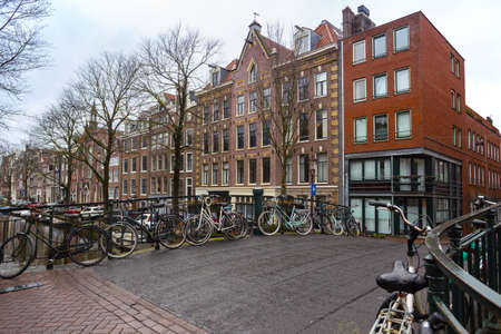 beautiful streets, bridges  and channels  in the famous city of amsterdam, netherlands Stockfoto