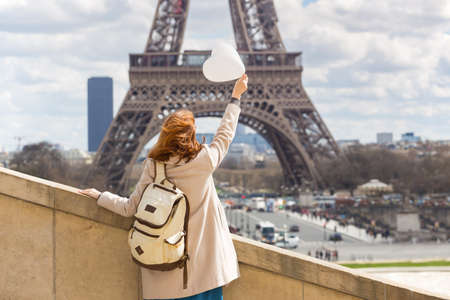 trip across Europe. girl with a balloon in the shape of a hearton the background of the Eiffel Tower in Paris. France Stock Photo