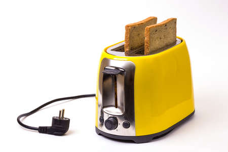 breakfast. yellow toaster on a white background Stock Photo