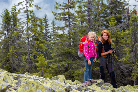 family - mother and daughter  hikers at the Carpathians mountains. gorgany, Ukraine.
