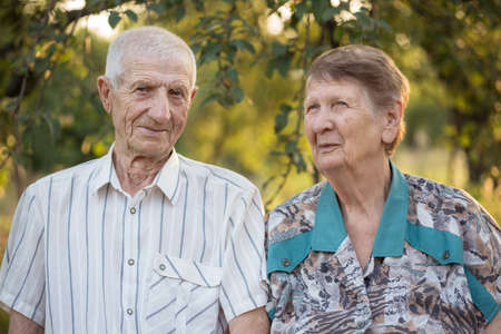 married couple. smiling grandparents. portrait of smiling senior man and senior woman at the garden. happy old age Standard-Bild - 131353865