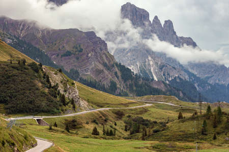 Mountain road - serpentine in the mountains Dolomites, Italy. Road trip
