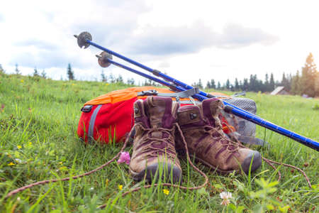 travel. the tourist goes on a hike through the mountains - a backpack, boots and Trekking poles