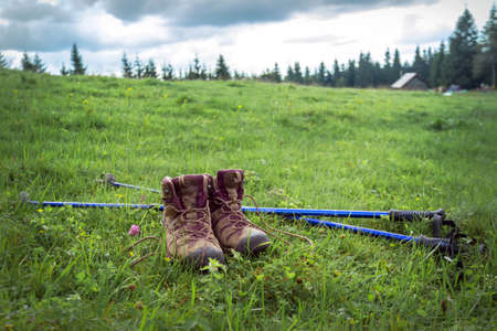 travel. the tourist goes on a hike through the mountains - a boots and Trekking poles