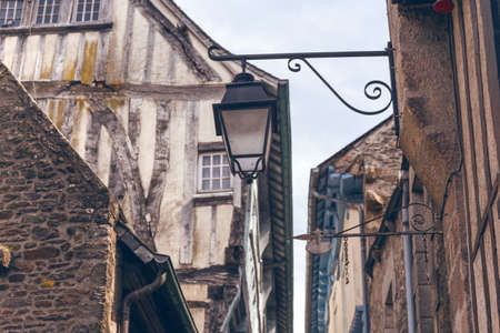 beautiful streets of the old famous city of Dinan in Normandy, France. street lamp in the foreground. Foto de archivo