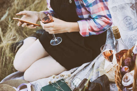 Summer - picnic in the meadow.  girl with a glass in hand Reklamní fotografie