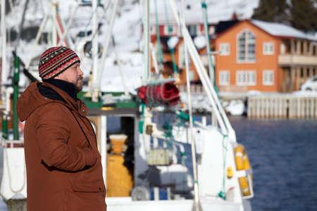 happy Norwegian man on the background of a bay in Lofoten