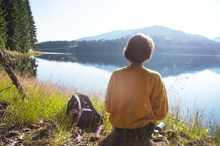 Summer - girl on a picnic by the lake. Lacul Vidra, Romania
