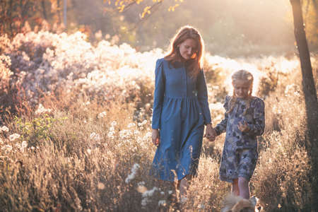 happy family.  smiling mom and daughter in the autumn park. Stok Fotoğraf