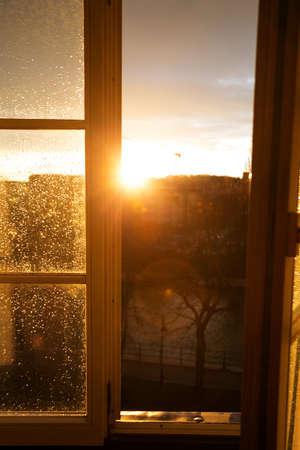 raindrops on a window pane at sunset