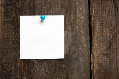 blank sheet for notes on wooden background