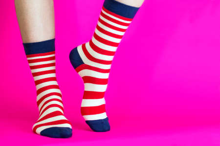 striped bright socks on a pink background