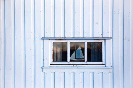 white norwegian house. window and ship. Lofoten Islands. Norway. world travel  Reklamní fotografie