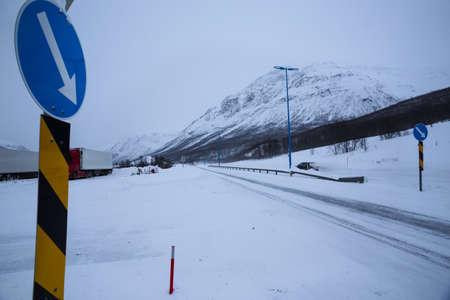 winter road at the norwegian mountains.  Lofoten Islands. Norway. Stock fotó