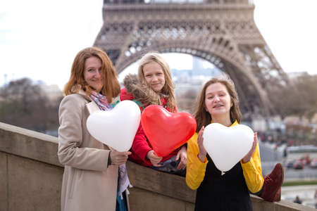 family trip. Happy mom and daughters on the background of the Eiffel Tower in Paris. France