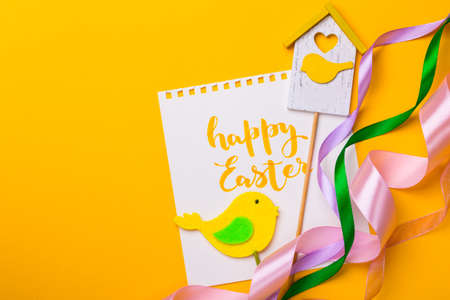 happy easter card on a yellow background