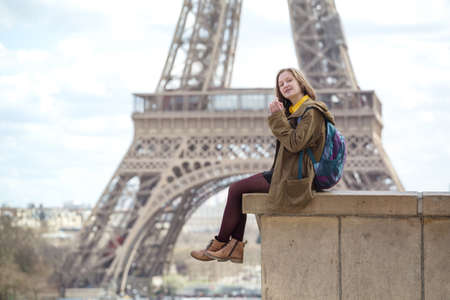 happy girl on the background of the Eiffel Tower in Paris. France