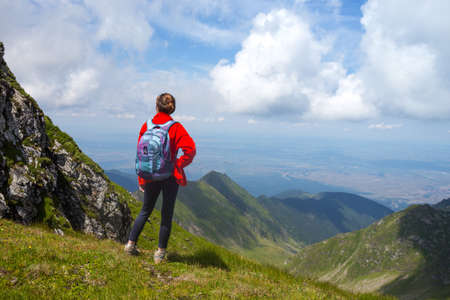girl hiker on a path at the mountains. Transfogaras. Romania Stock Photo