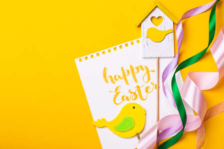 happy easter card. beautiful Easter egg Pysanka handmade - ukrainian traditional on a yellow background