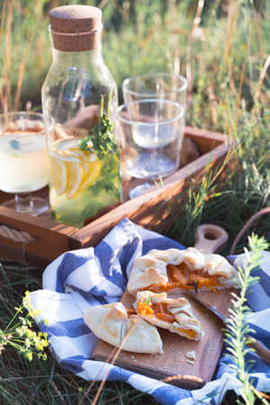 Summer - lemonade with lemon and mint with apricot biscuit and a basket