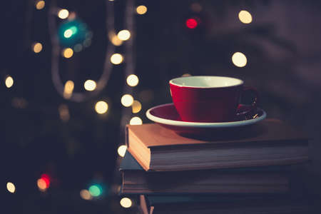 books and red cup of coffee with  croissant on Christmas  background Stock Photo