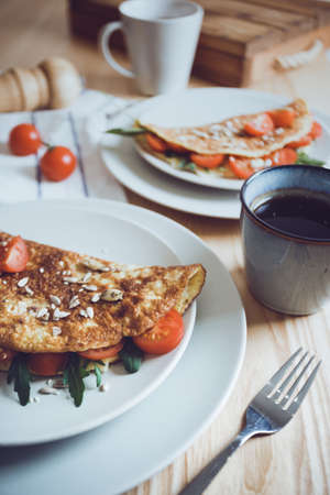 healthy nutrition. omelet with herbs, tomato and cheese Stock Photo