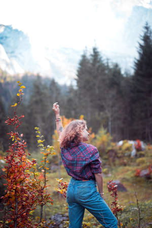 happy girl in the mountains. travel and mood
