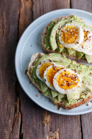 healthy nutrition and light breakfast - toast with avocado and egg